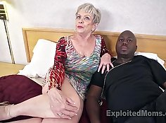 Busty shaved mature rides a black cock and gets cum in her mouth