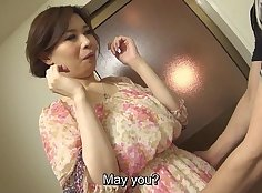 Bare-hosed Japanese Milf enjoys stripping and caressing a dick