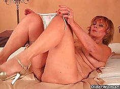Skinny grandma with massive tits rides the cock in her pussy